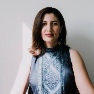 Artist Gazelle Samizay sitting facing the camera