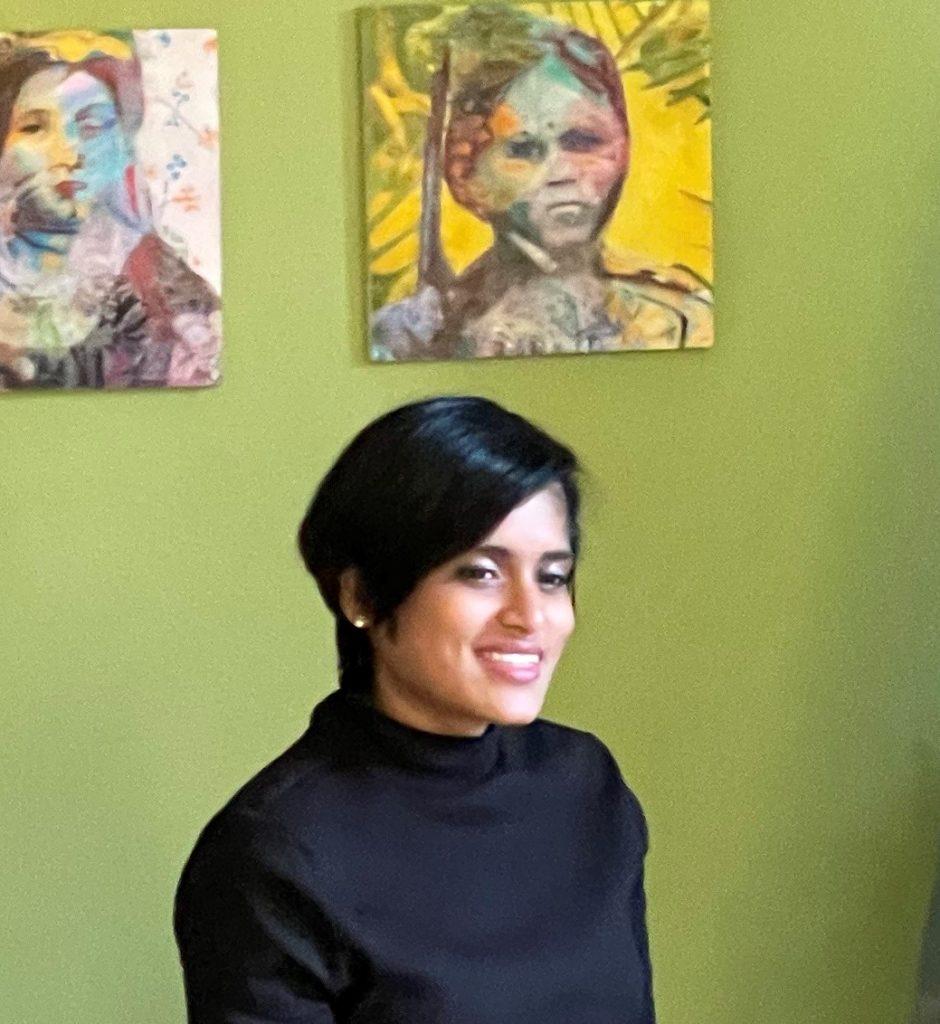Image of Nimisha Doongarwal, a female artist sitting in her studio